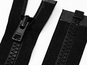 Gezahnter Kundtstoffreißverschluss in schwarz zur Veranschaulichung.
