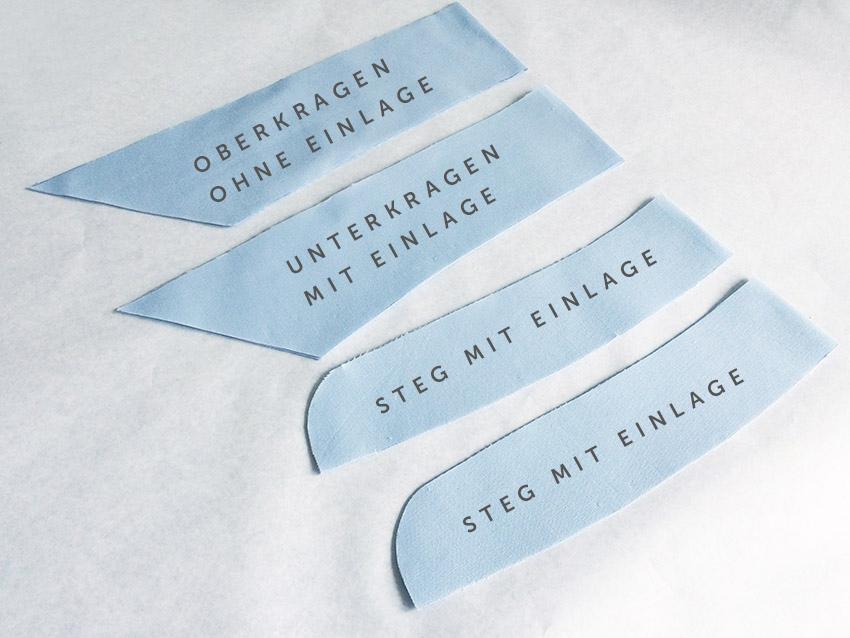 Die vier Kragen und Stegschnittteile aus Stoff mit und ohne Einlage.