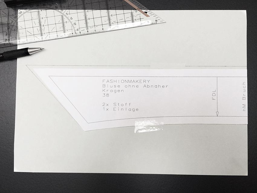 Unterkragen auf ein Blatt Papier legen und die Mehrweite für den Oberkragen anzeichnen.